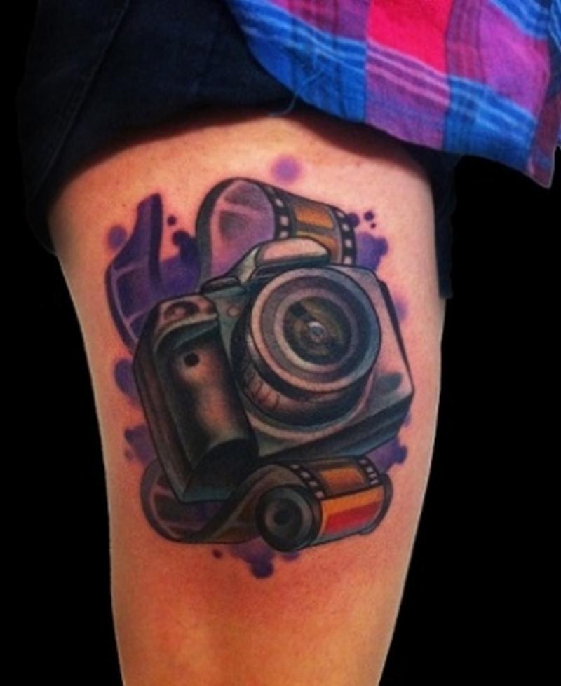 Superb camera tattoo on thigh