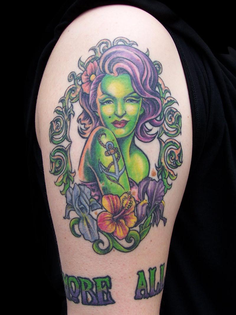 Superb zombie girl tattoo on shoulder