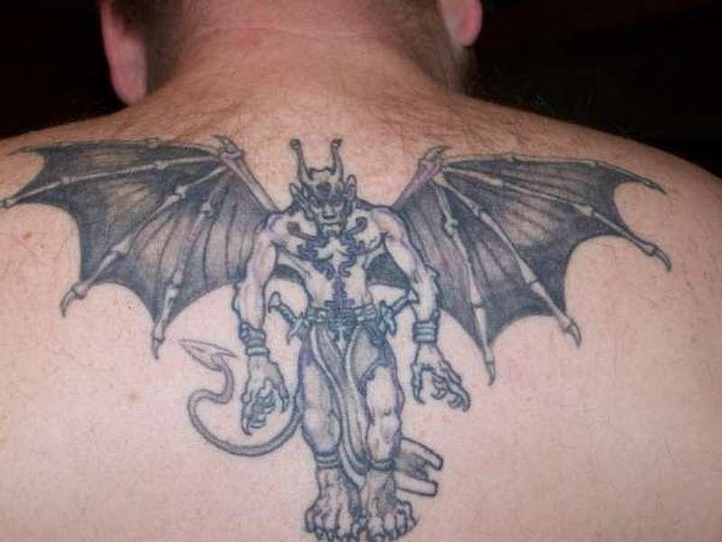 Tattoo of gargoyle on upper back 1