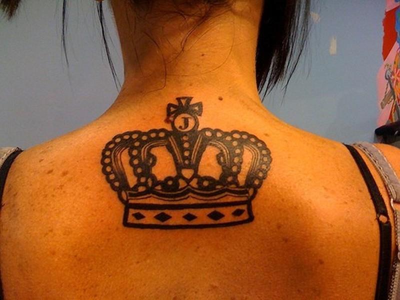 Tattoo on upper back black crown
