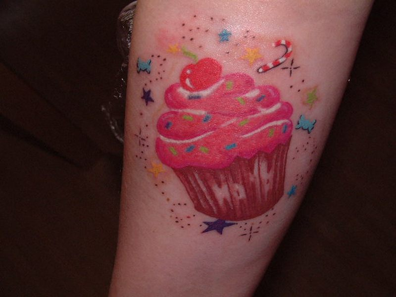 Terrific cup cake tattoo design