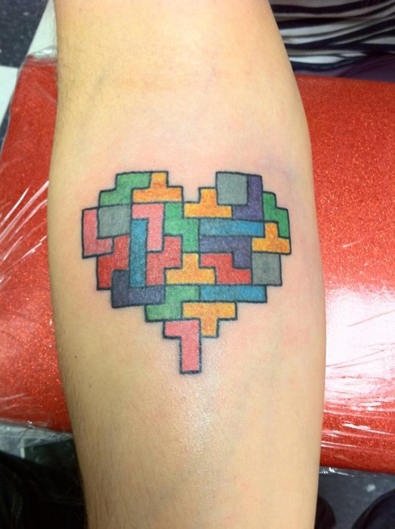 Tetris heart tattoo on forearm