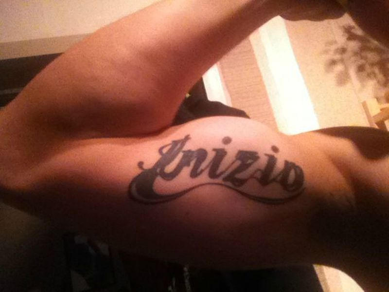 Name tattoo on bicep
