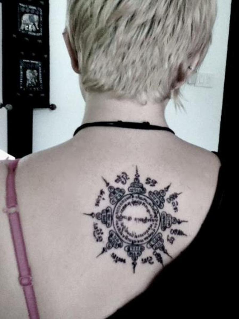 Thai buddhist on upper back tattoo