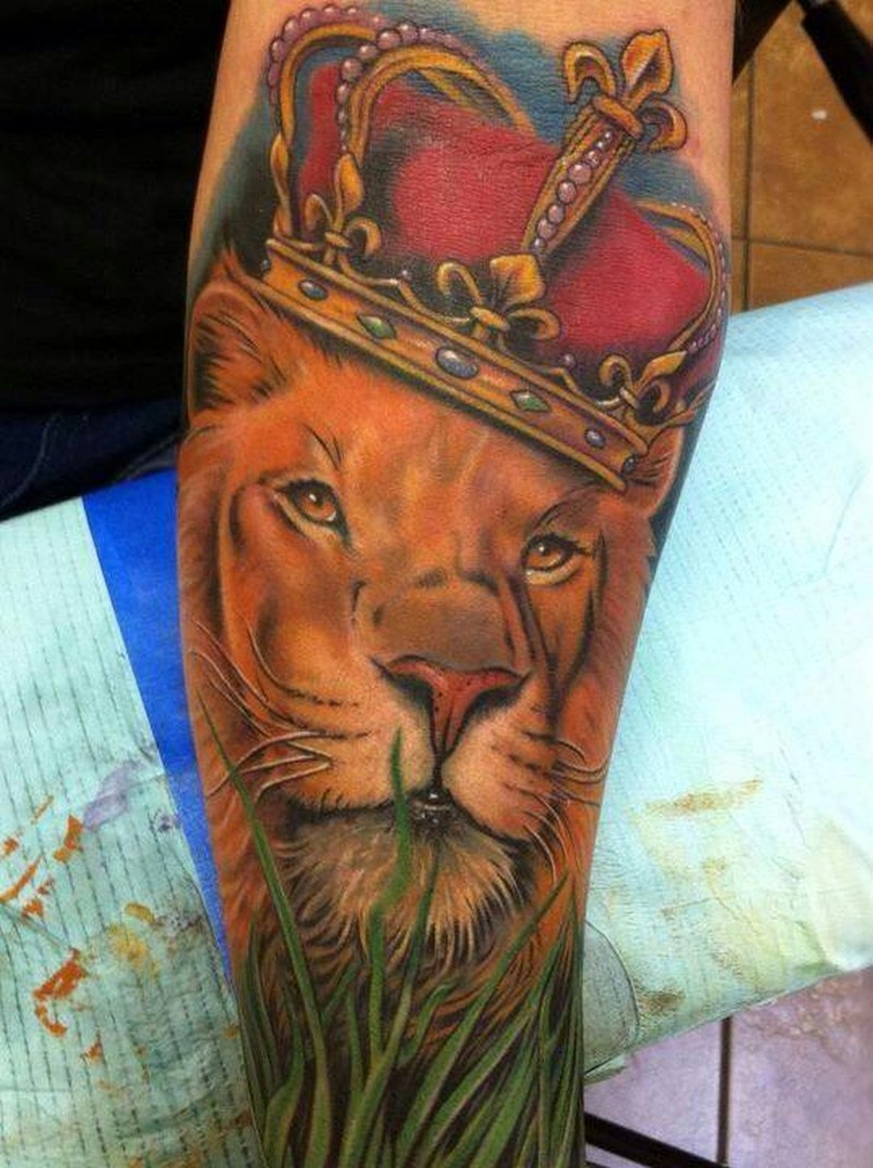 This lion tattoo adds to the royal meaning of lions by including a jeweled crown in the design