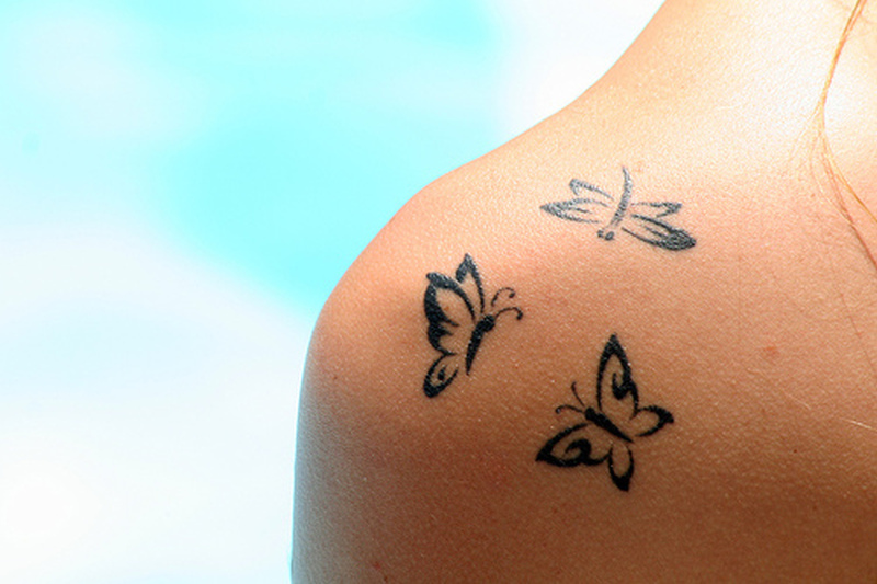 Three tribal butterflies tattoo design