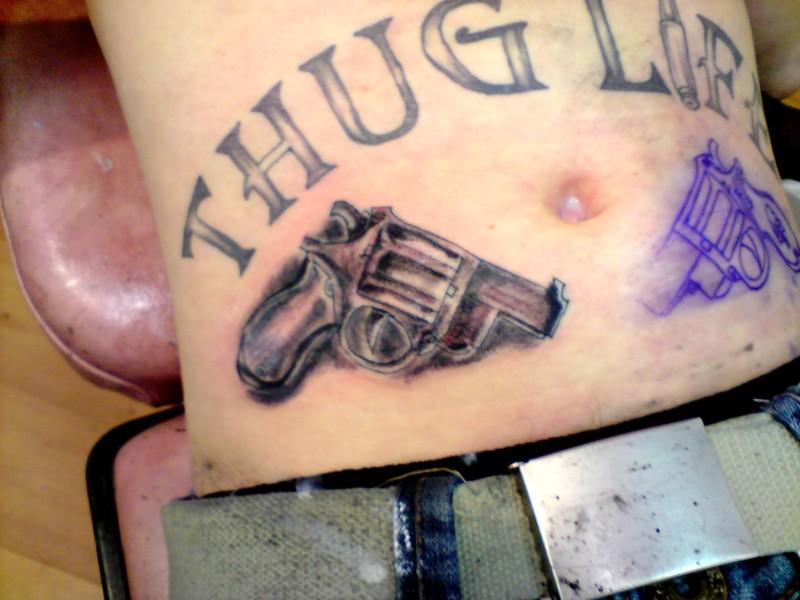 Thug life gun tattoo on stomach