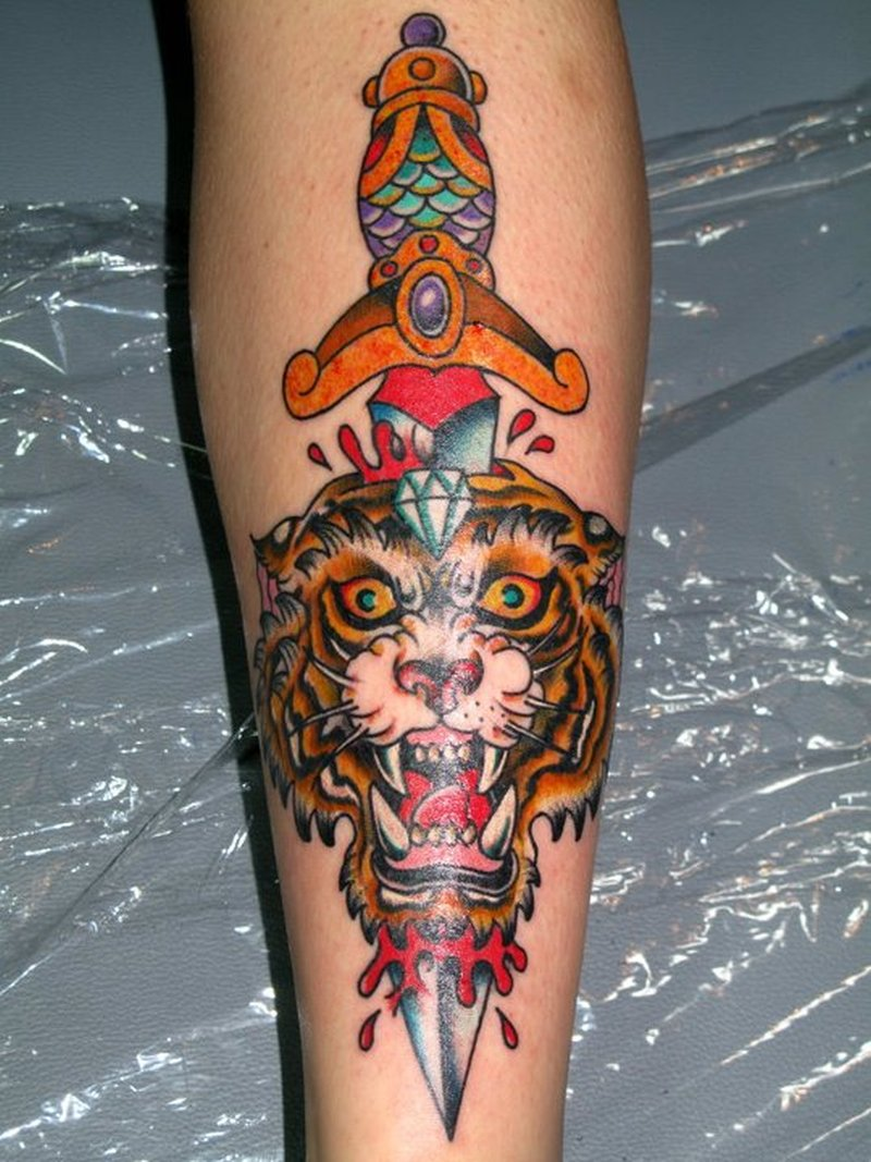 Tiger dagger design tattoo