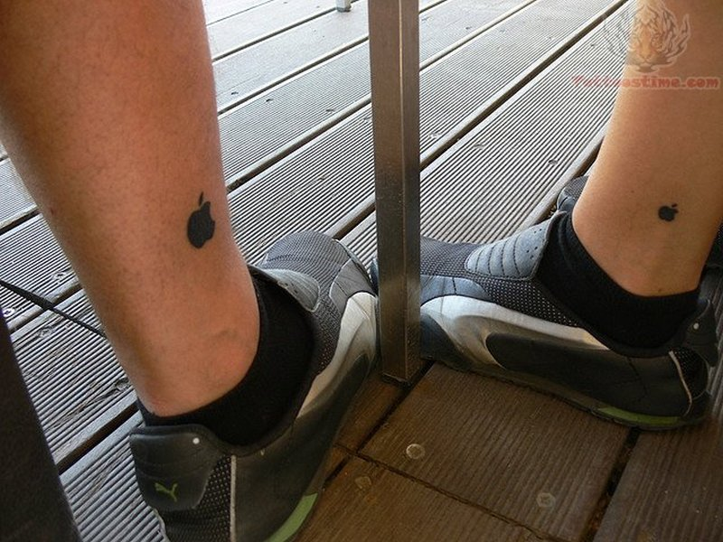 Tiny apple tattoo design on legs