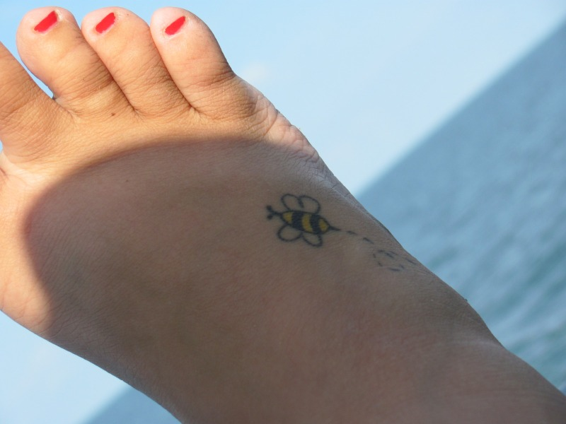 Tiny bumblebee tattoo for foot