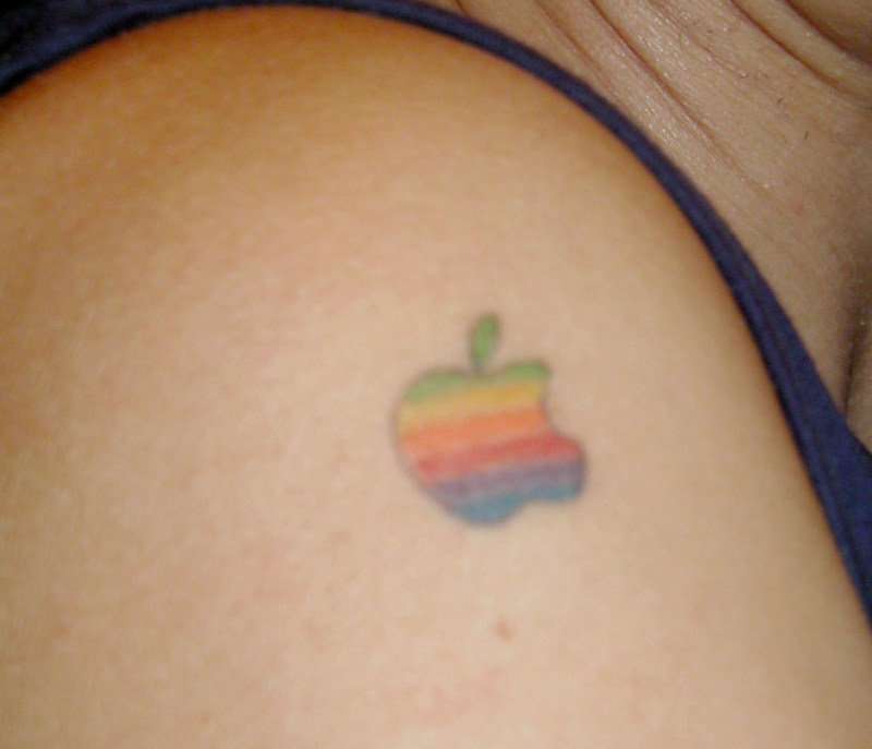 Tiny color ink apple tattoo