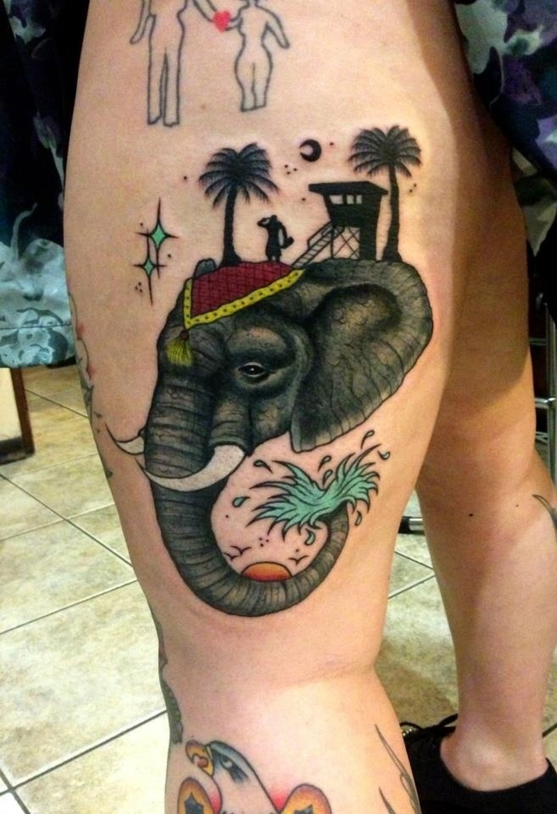 Traditional elephant tattoo on left thigh