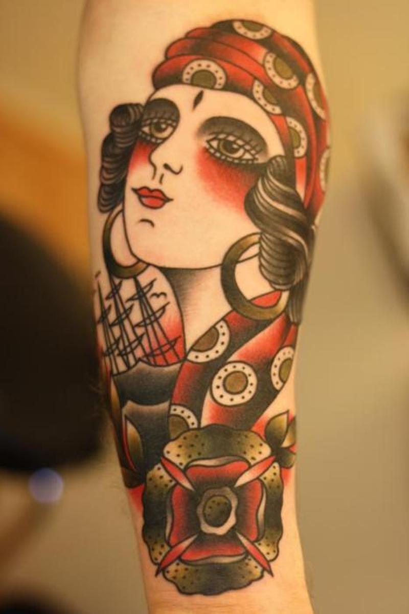 Traditional gypsy woman tattoo on arm
