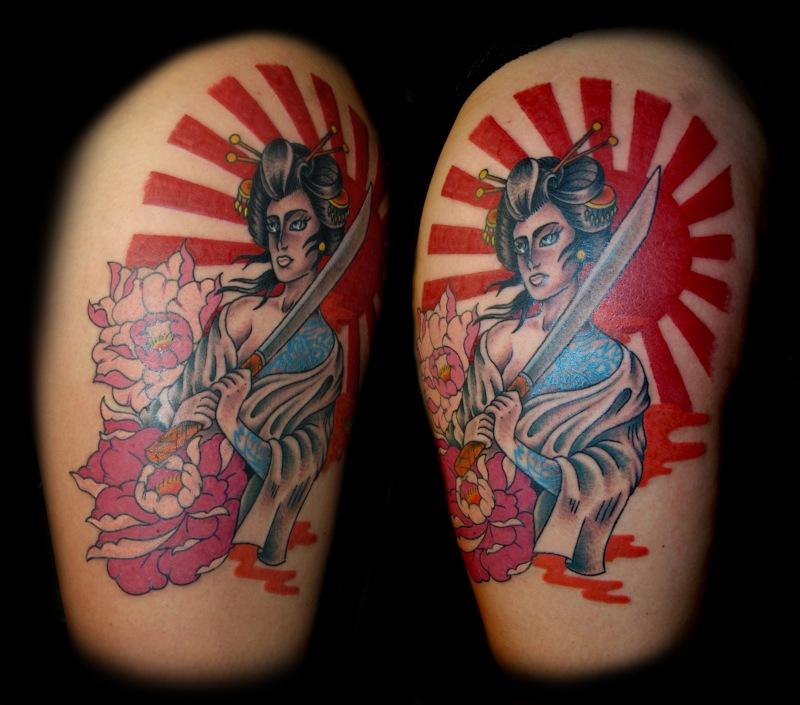 Traditional japanese geisha tattoo on thigh