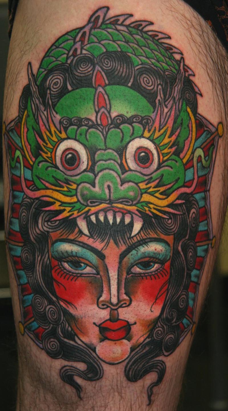 Tradtional dragon n gypsy head tattoo on knee