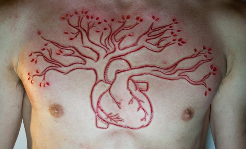 tree grown from heart skin scarification on chest tattoo tattoos book tattoos designs. Black Bedroom Furniture Sets. Home Design Ideas
