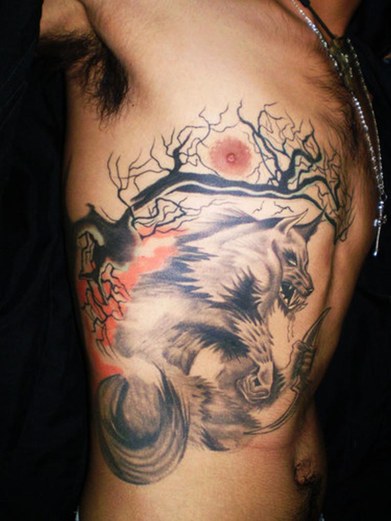Tree n wolf horror tattoo on rib side