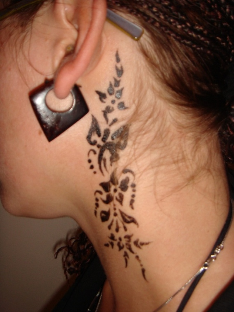 Tribal flowers behind the ear tattoo