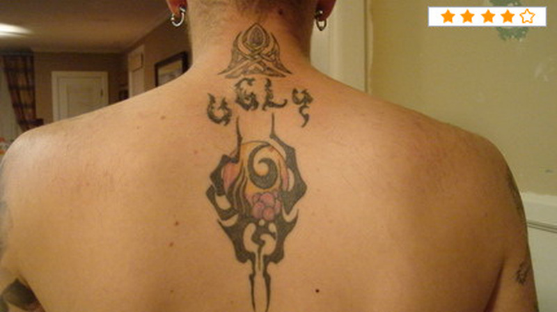 Tribal grim reaper on upper back tattoo