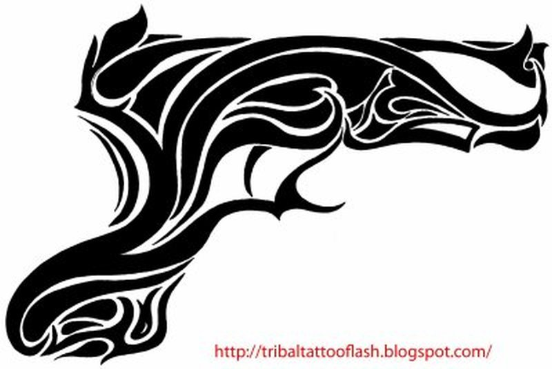 Tribal gun design tattoo