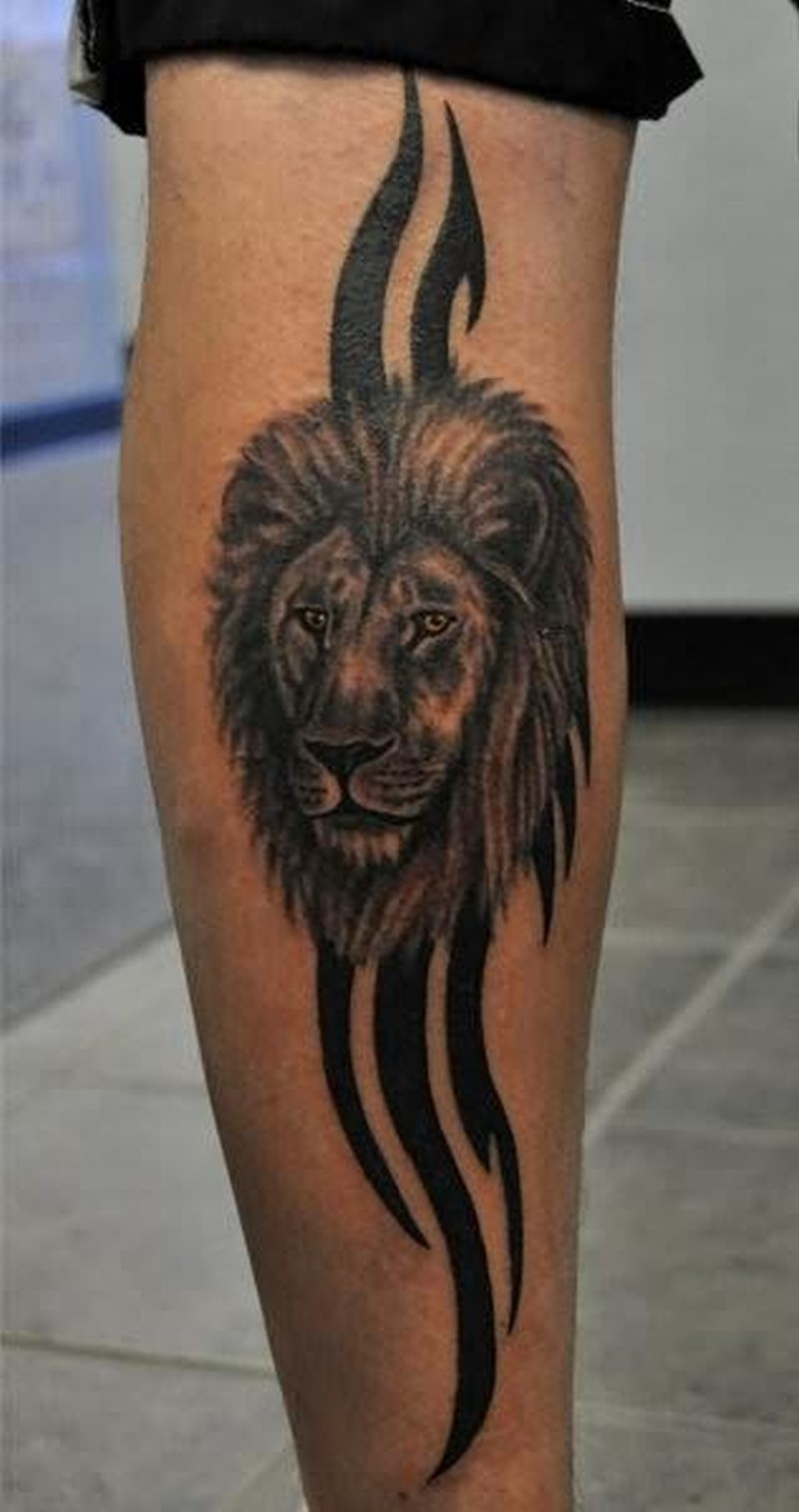 Tribal lion face tattoo design