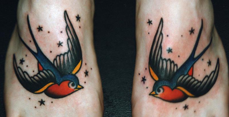 Twin bird tattoo on feet