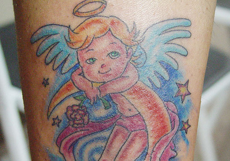 Twinkling baby angel tattoo