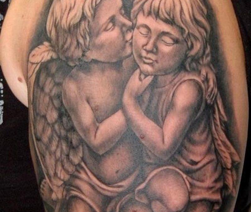 Two cherubs kneeling tattoo on arm