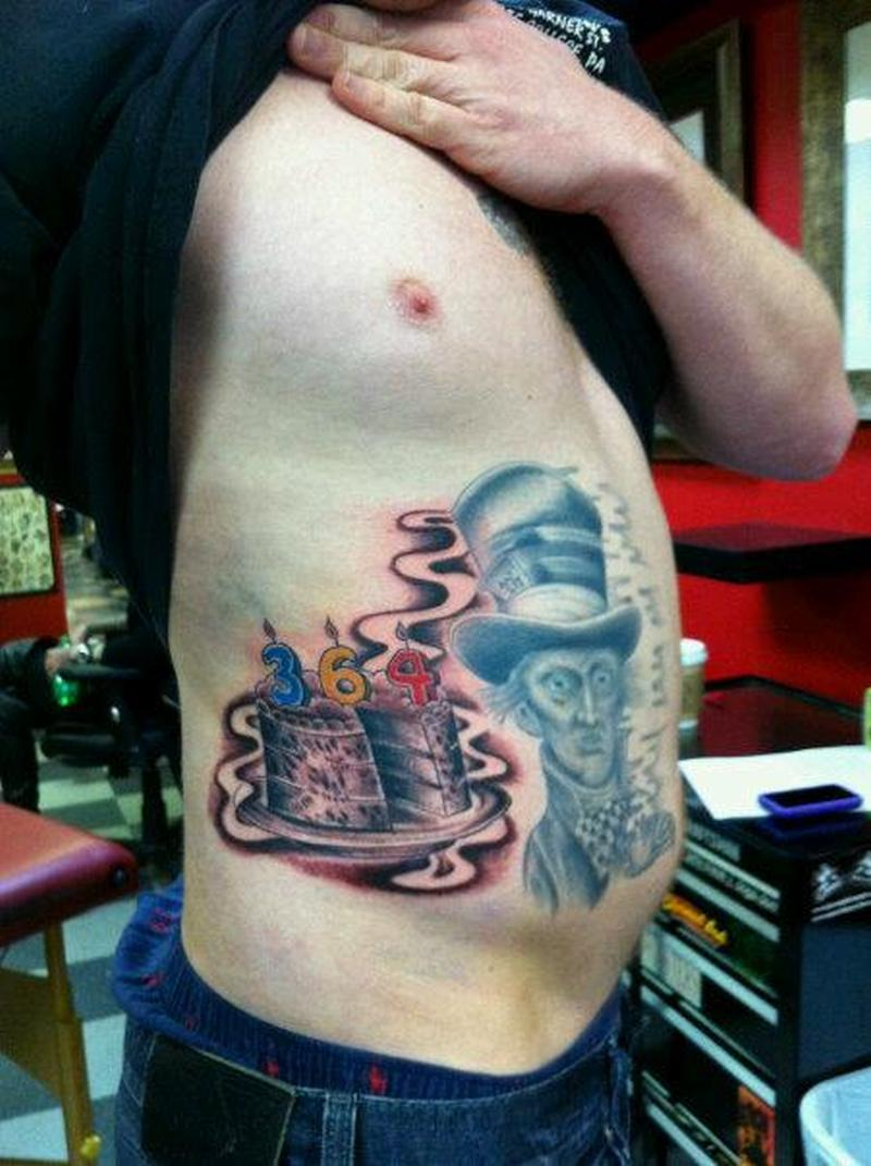Unbirthday cake tattoo for men