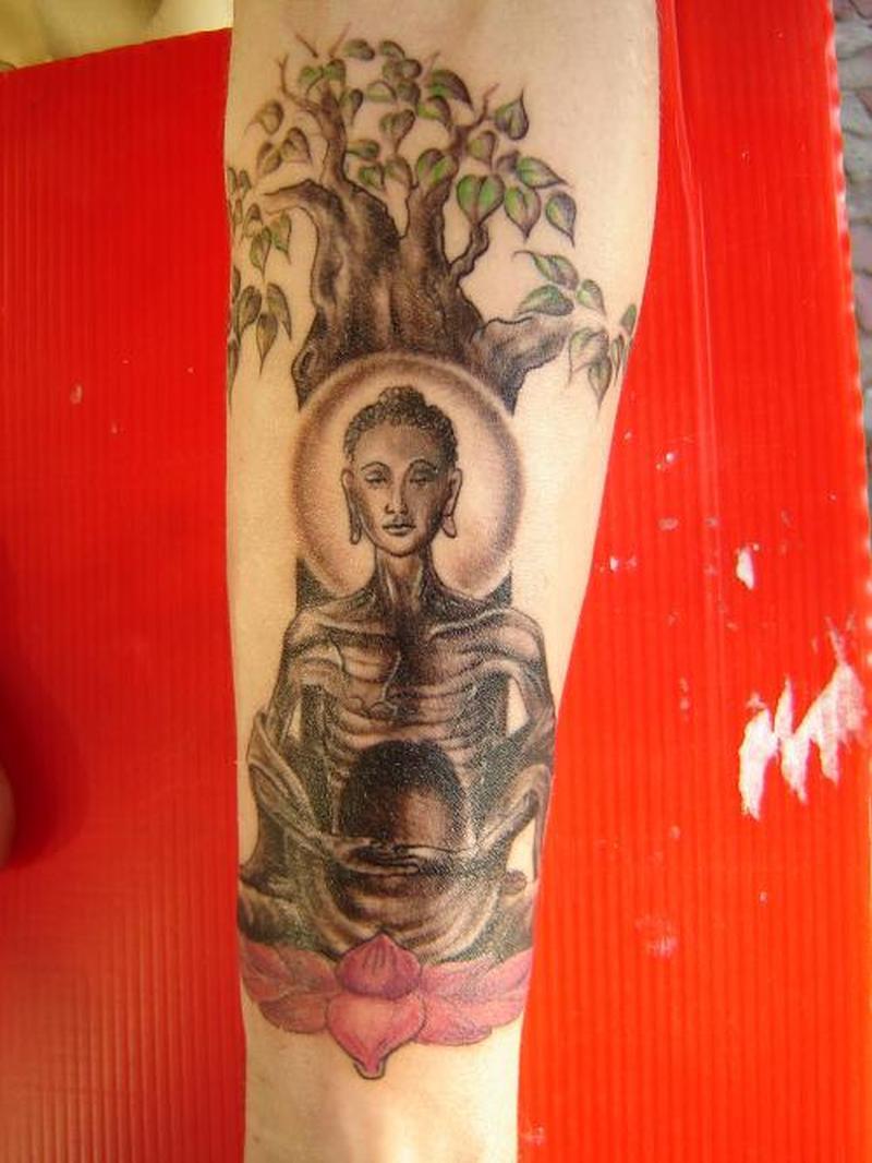 Under tree skeleton buddha tattoo on arm