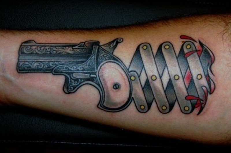 Unique gun tattoo design