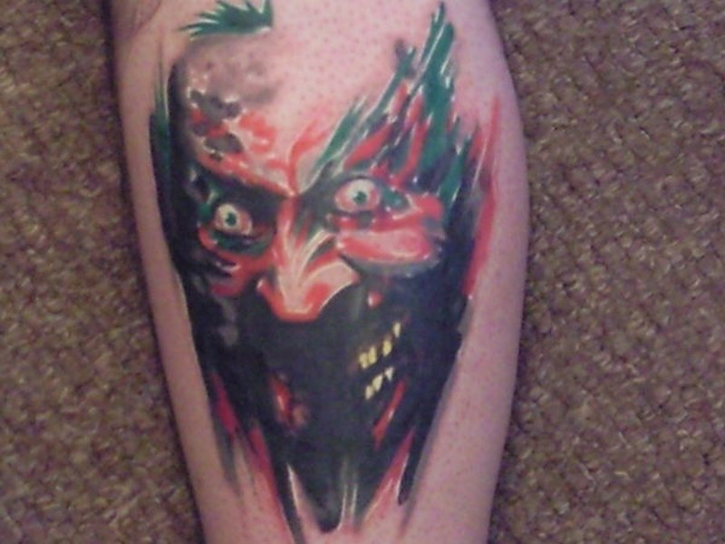 Unique scary joker tattoo design