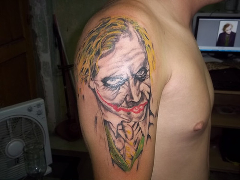 Upper arm batman joker tattoo design