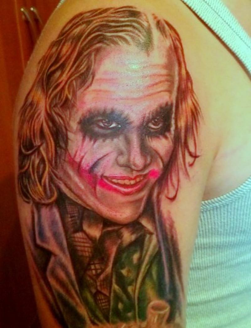 Upper arm health ledger joker tattoo on arm