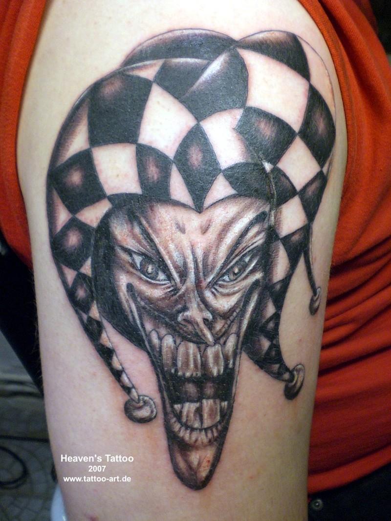 Upper arm joker tattoo for men