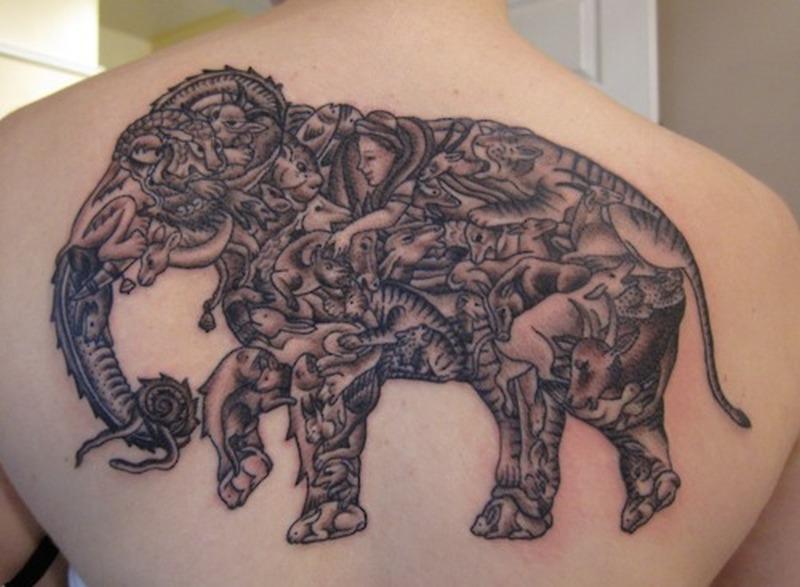 da173e5905515 Upper back elephant tattoo design for men - Tattoos Book - 65.000 ...