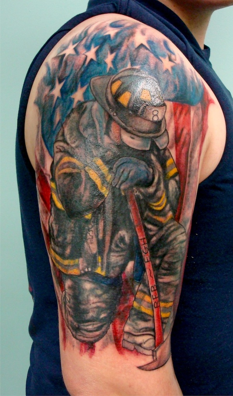 Us firefighter tattoo on shoulder