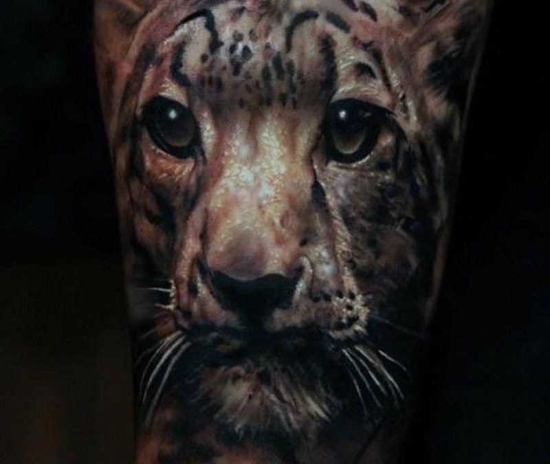 Very nice leopard head tattoo by Domantas Parvainis