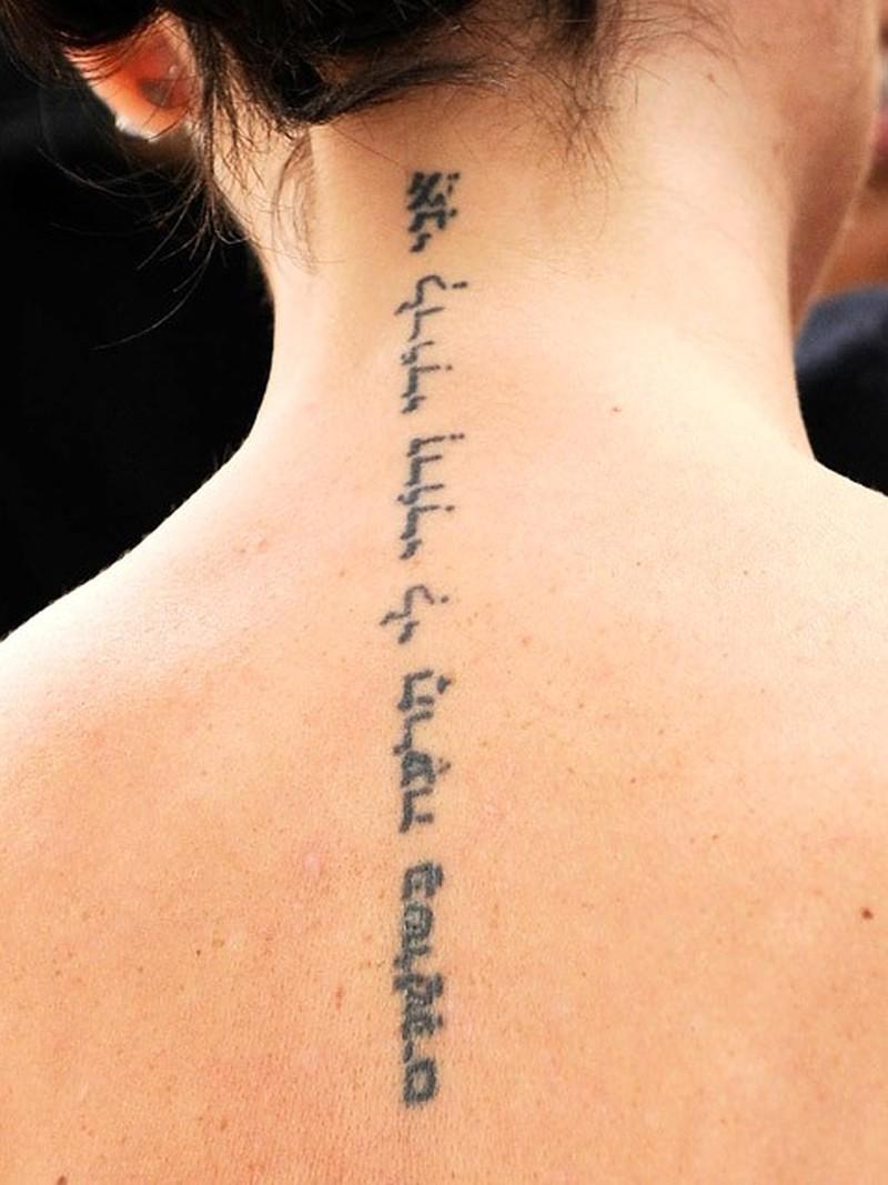 Victoria beckham spine hebrew tattoo design