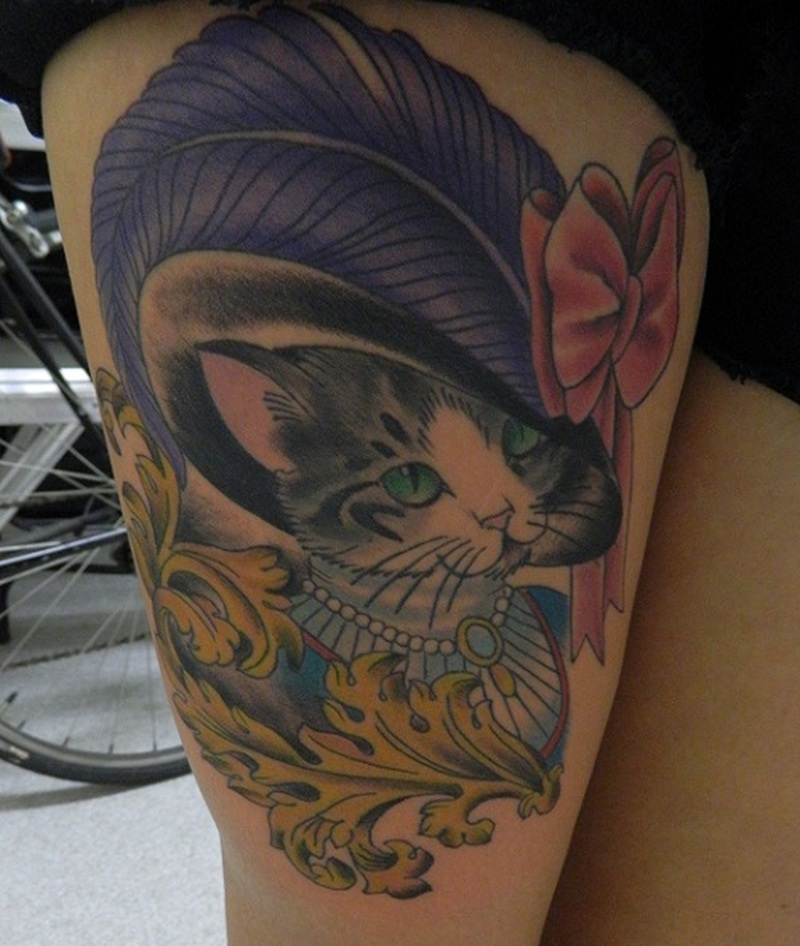 Victorian cat tattoo on thigh