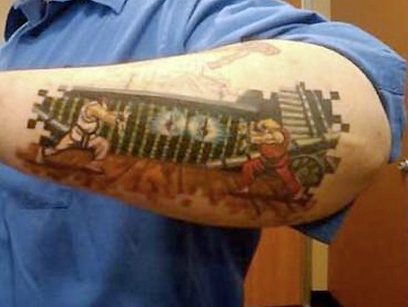 Video game geek tattoo on arm