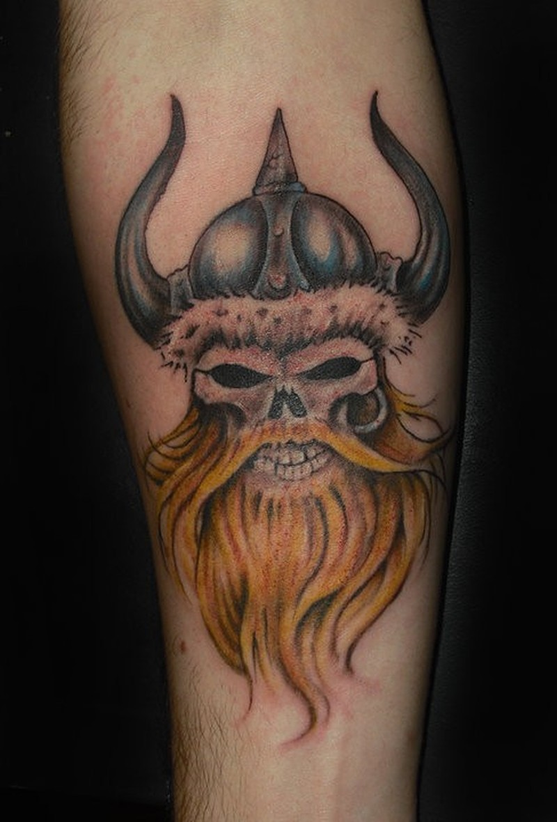 Viking skull with a red beard in a horned helmet tattoo for Red beard tattoo