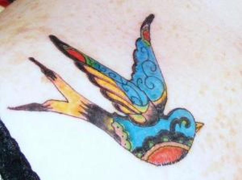 Vintage bird tattoo