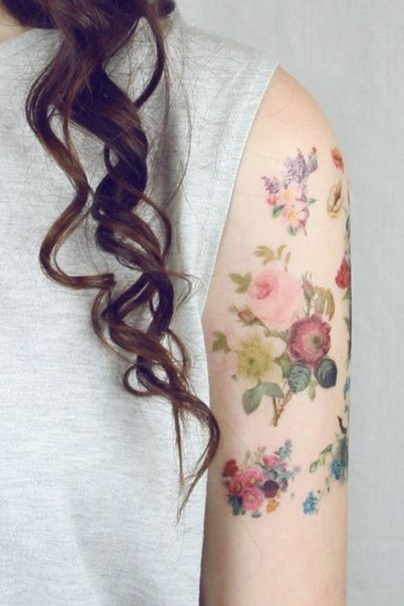 Vintage bouquets of flowers tattoo on arm