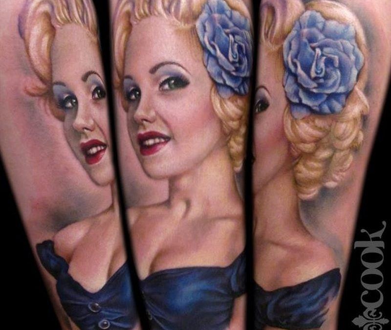 Vintage pinup girl with blue rose tattoo by Liz Cook