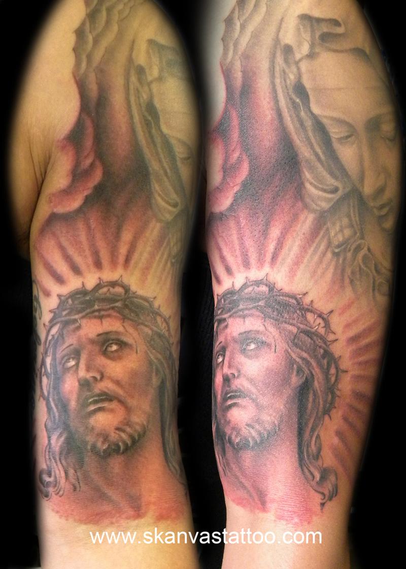 Virgin mary n jesus tattoo on arm