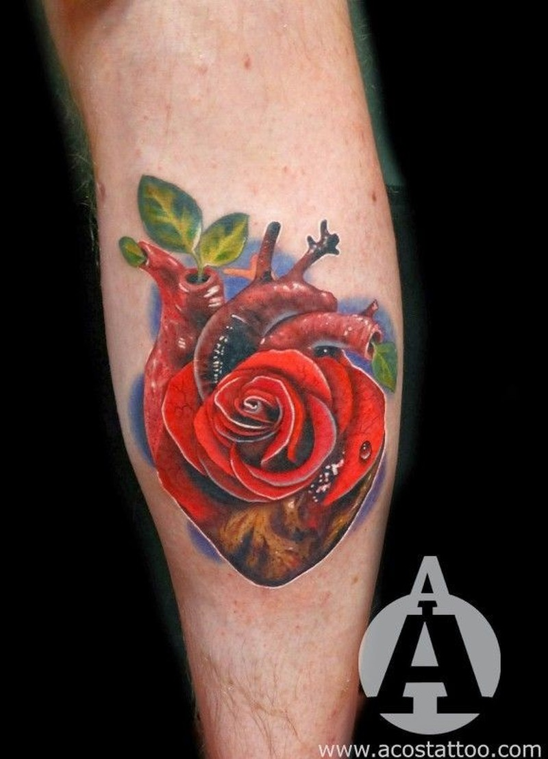 Vivid colors heart with rose tattoo by Andres Acosta