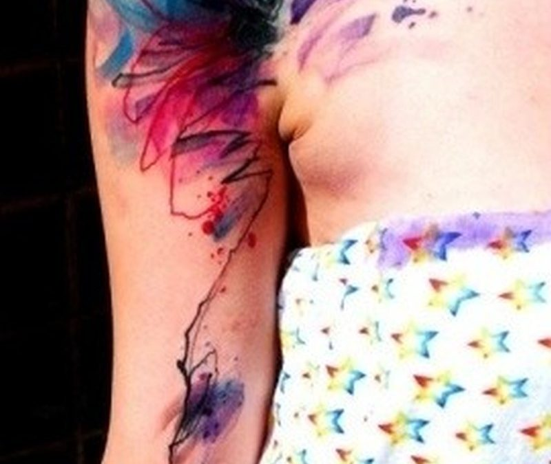 Vivid colors watercolor abstraction tattoo on shoulder