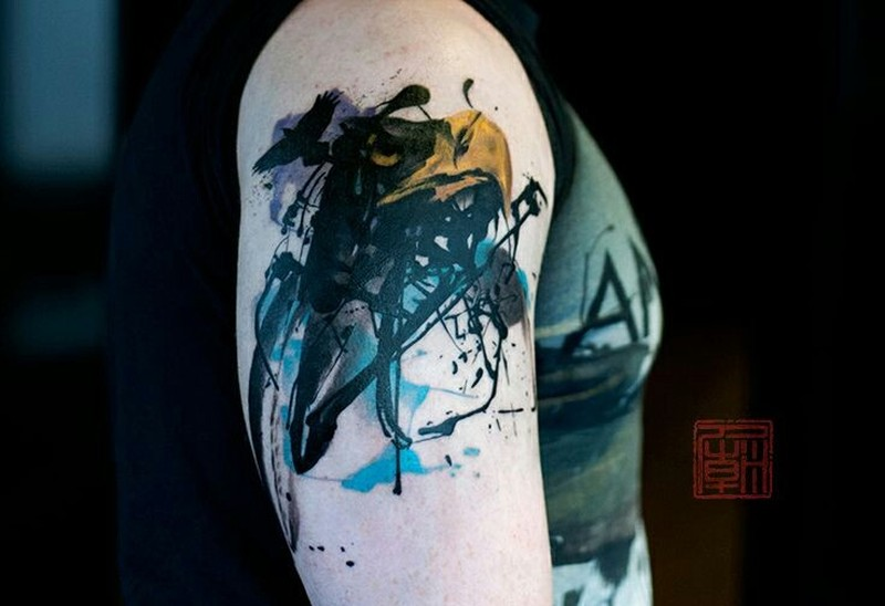 Watercolor abstract bird tattoo on shoulder