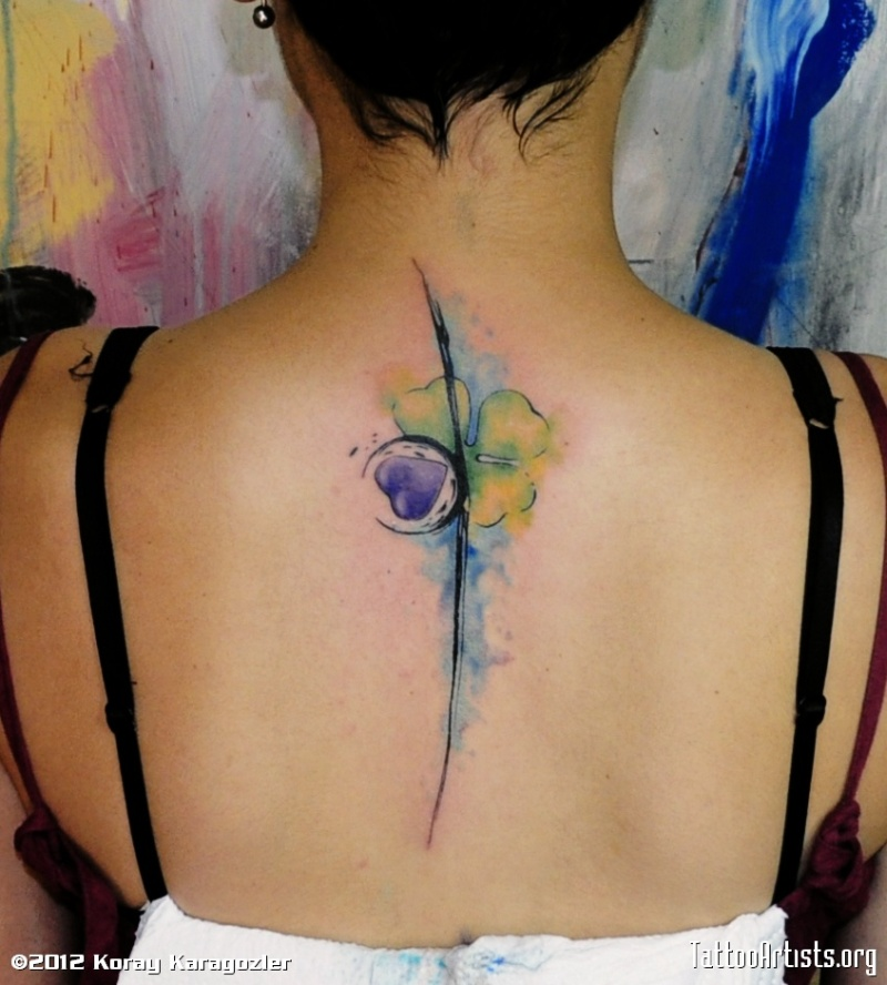 Watercolor clover tattoo on back